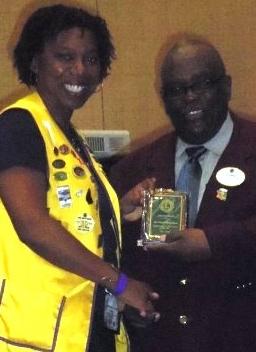 Lion B receiving president's award.jpg